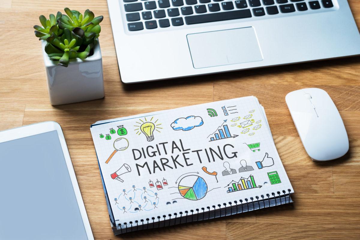 Notepad Showing Digital Marketing Diagram On Wooden Desk